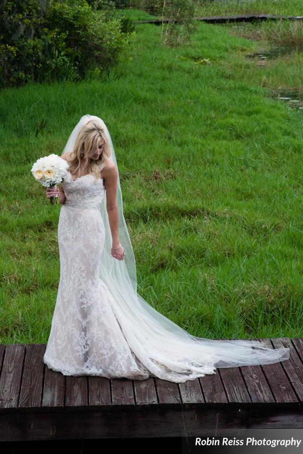 The bride carried a bouquet of ivory hydrangea & garden roses, suited perfectly for her lace gown