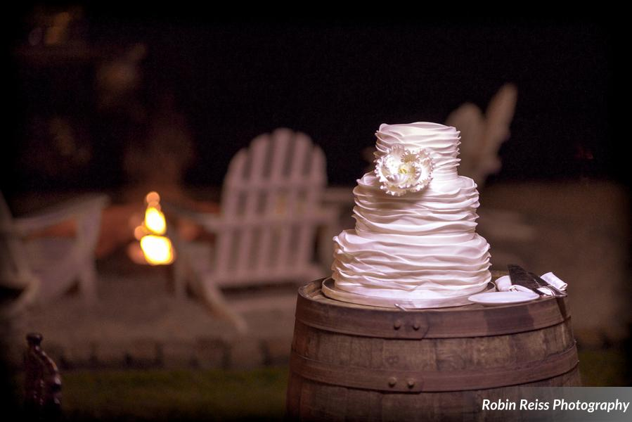 A ruffled fondant cake sat perched atop a vintage barrel, while a firepit beckoned guests with smores