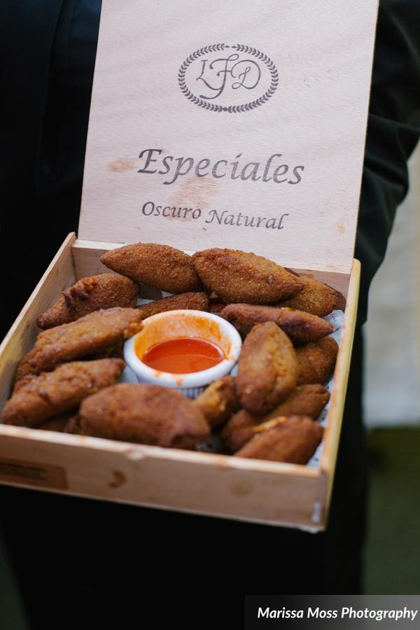 Passed hors d'oeuvres of empenadas and plantains in cigar boxes (a nod to the city of Tampa)