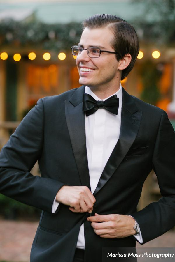 The groom looked so sharp in his classic black tuxedo and bowtie