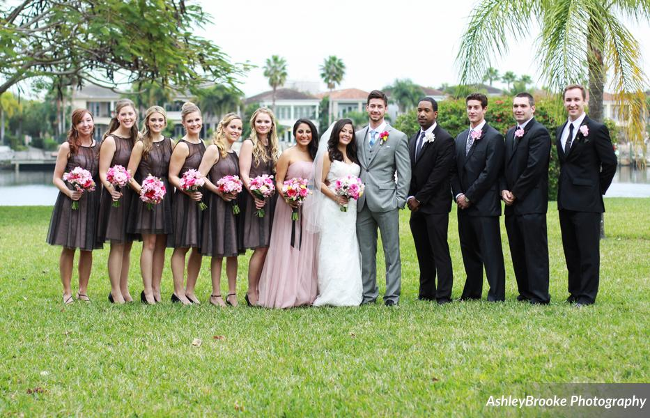 Bridesmaids wore black over blush tulle dresses, and groomsmen sported black suits