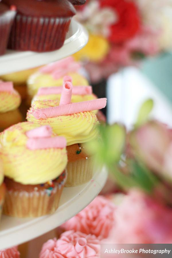 The cupcakes echoed the pink &yellow colors, with flavors like birthday cake &pink lemonade