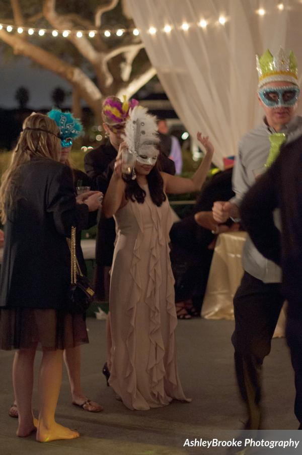 The bride changed into a party dress and mask for La Hora Loca (the crazy hour)