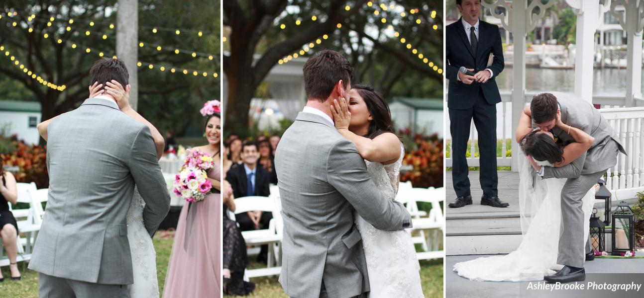 The bride and groom seal their union with a passionate kiss!