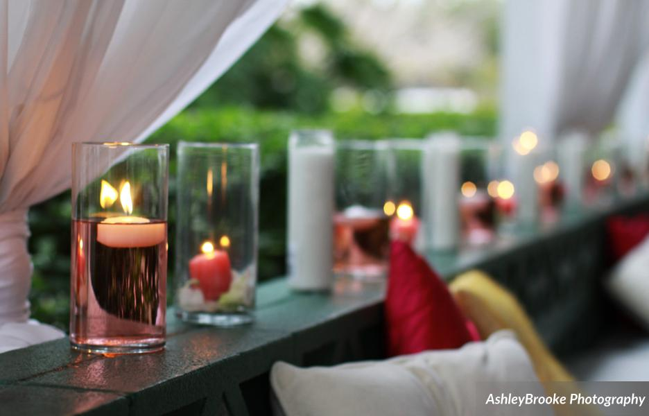 The patio wall was lined with candles and colorful pillows along the benches for cocktail hour