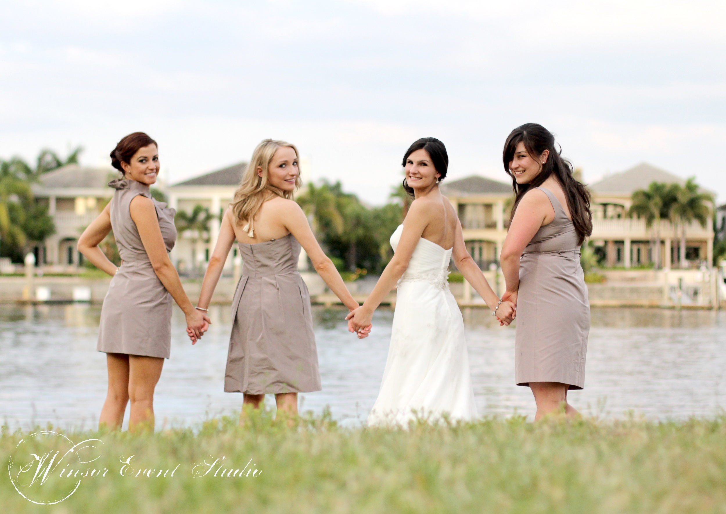 Bridesmaids wore mismatched cocktail dresses from J Crew in a soft shade of taupe