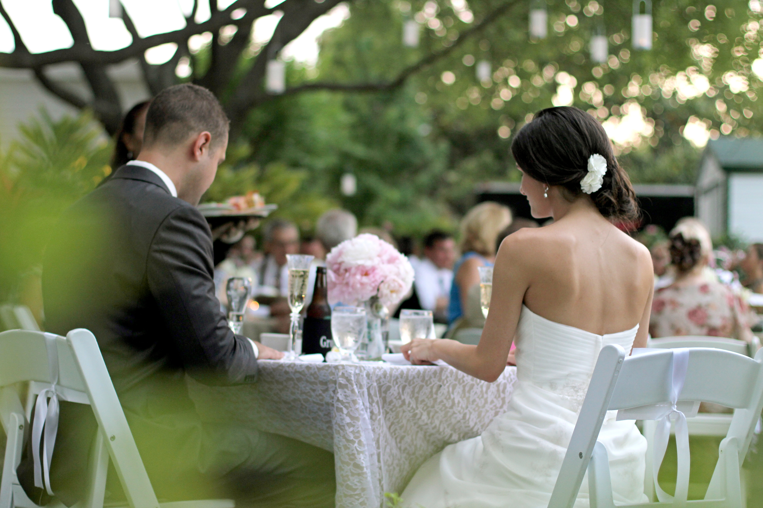 The al fresco reception was set under a canopy of oak trees with suspended lanterns in the branches