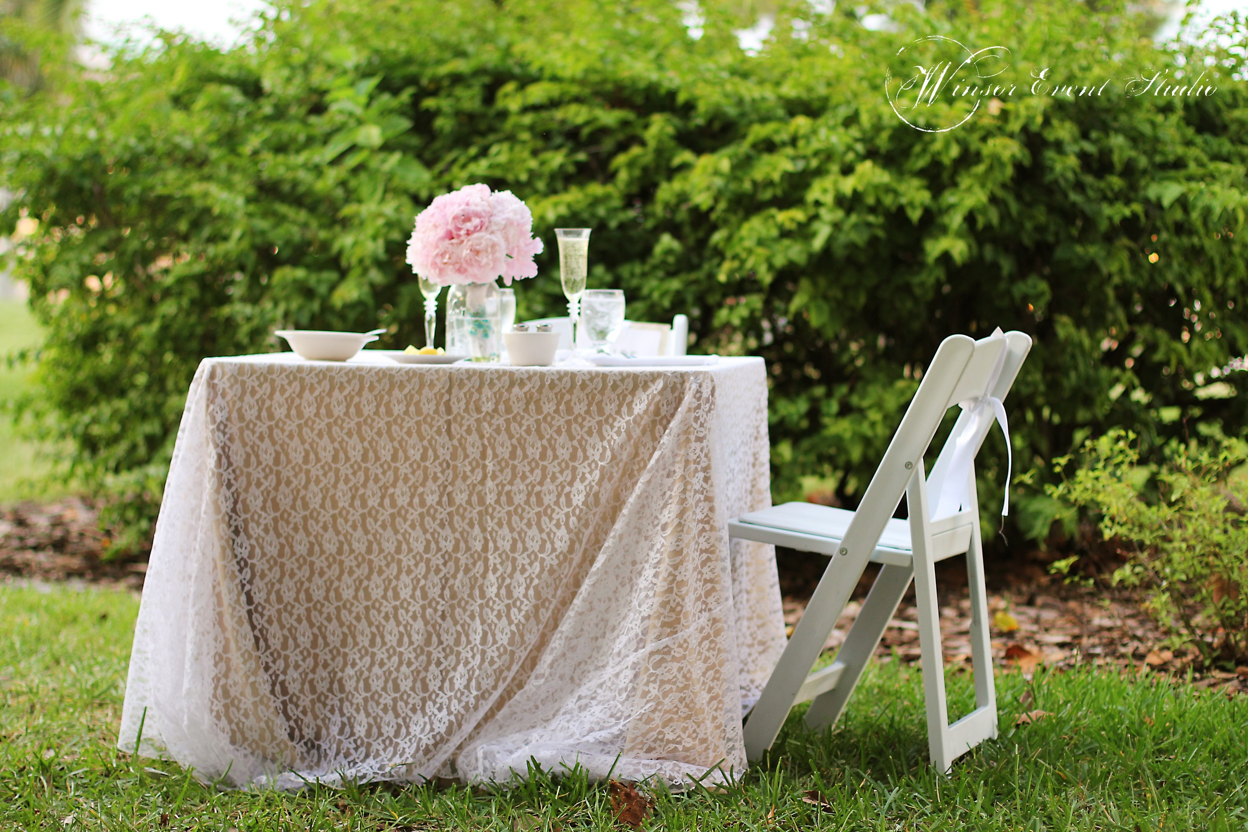 Tables were dressed with neutral linens and delicate lace overlays