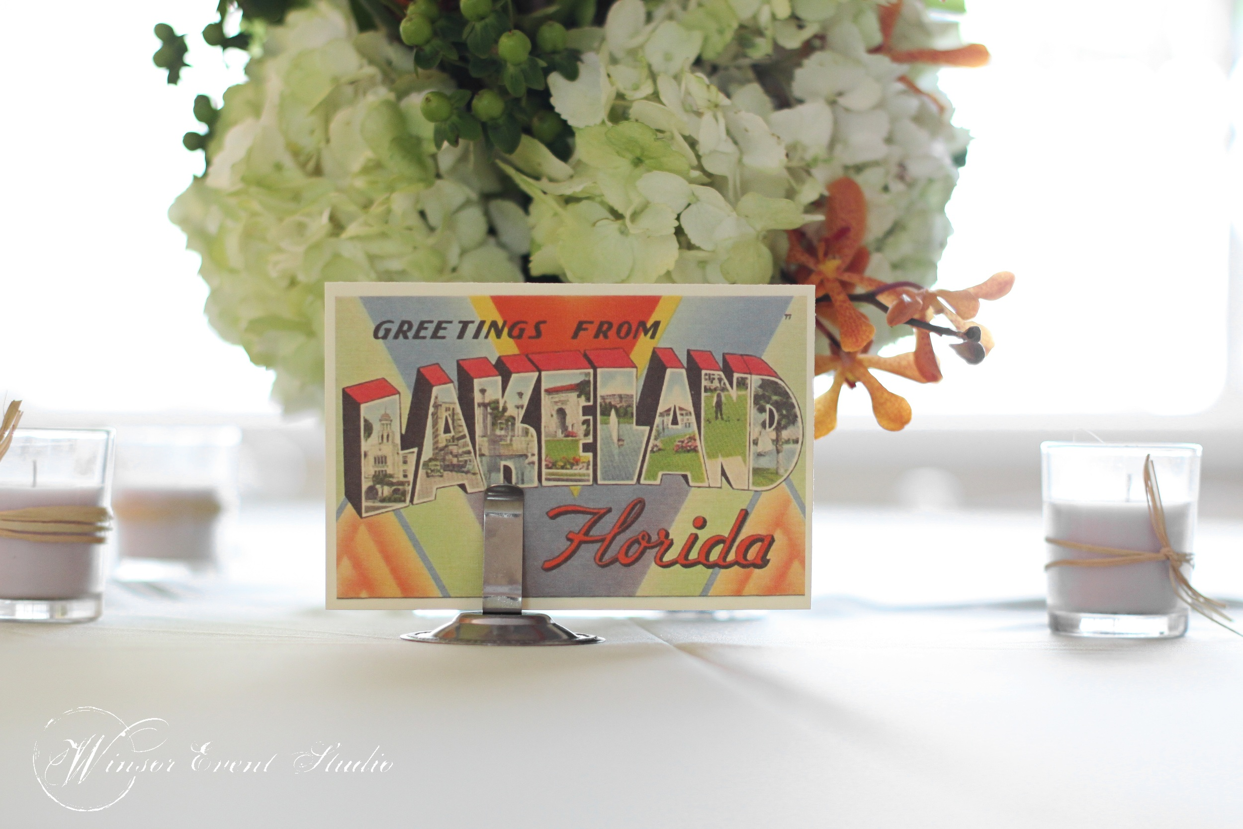 Tables were named after cities in Florida, with vintage postcards on display