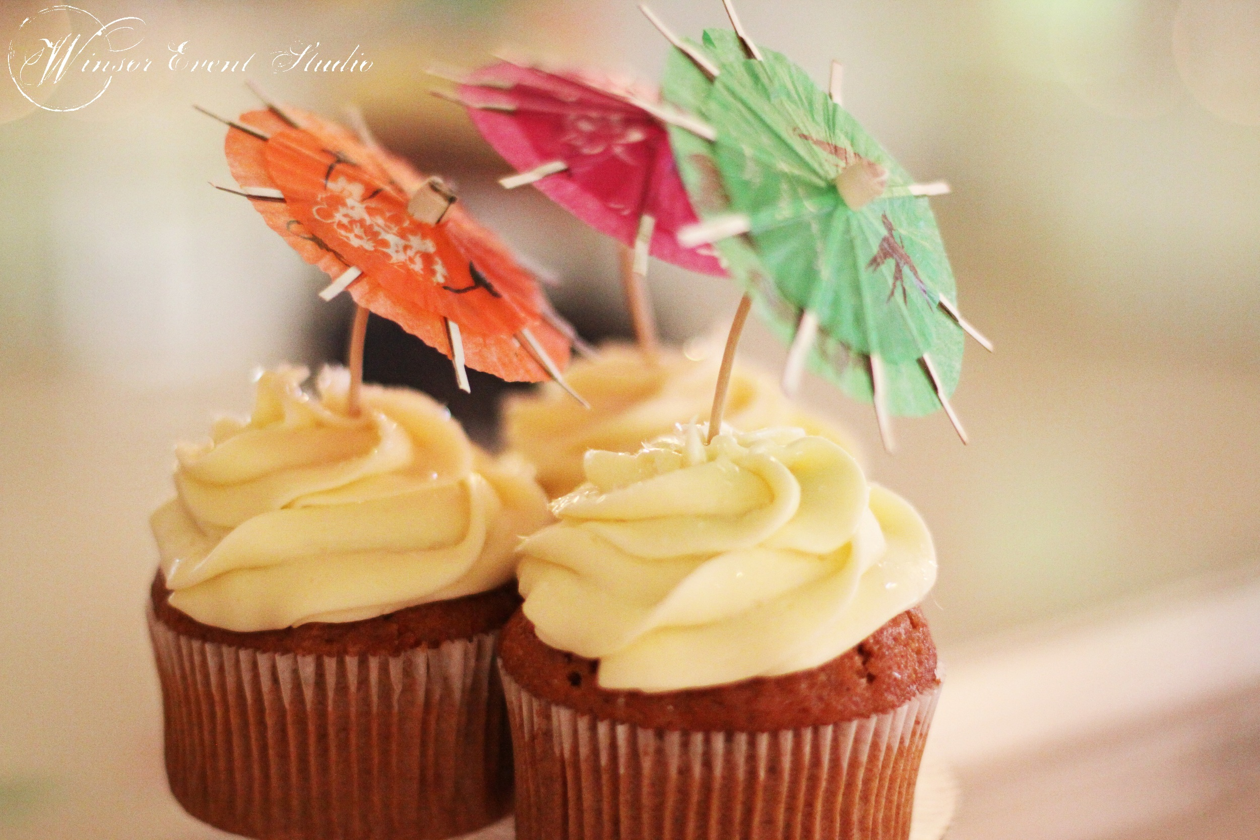Red velvet cupcakes were accented with bright paper umbrellas to echo the tropical theme