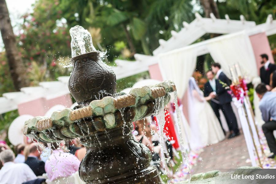 The couple was married in front of a draped arch in the Vinoy tea garden