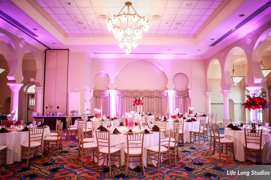 The Vinoy sunset ballroom was lit with soft pink uplighting along the columns