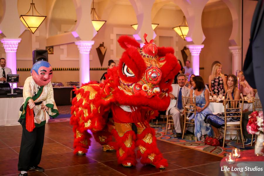 A dragon dancer introduced the bride and groom into the reception and performed for the guests