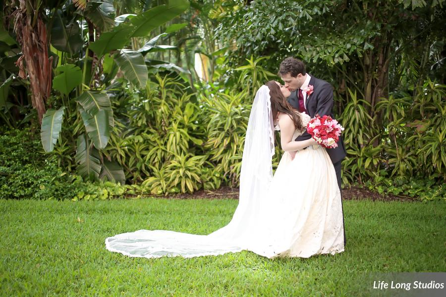 The bride wore a ballgown and dramatic cathedral length veil