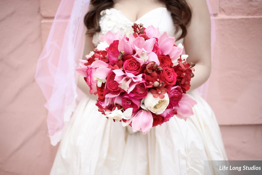 The bride's bouquet combined pink and red roses and exotic orchids