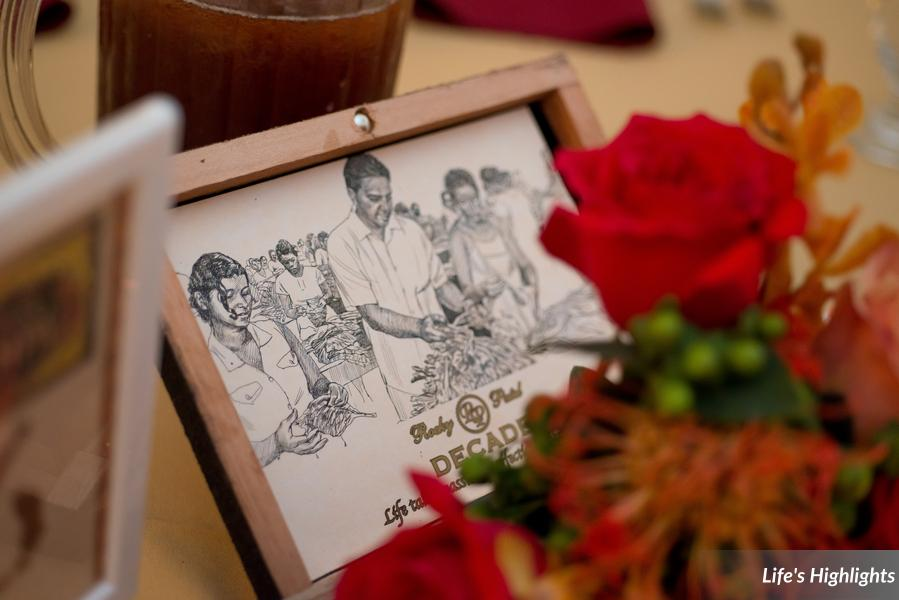 Authentic cigar boxes were filled with colorful flowers as table centerpieces