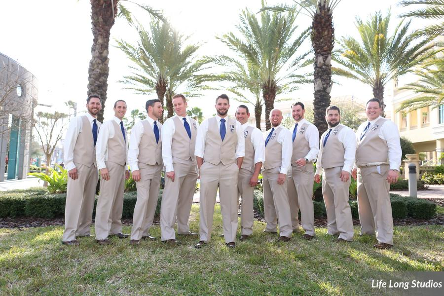 Gentlemen looked dapper in their khaki pants and vests, navy ties, and ribbon boutonnieres