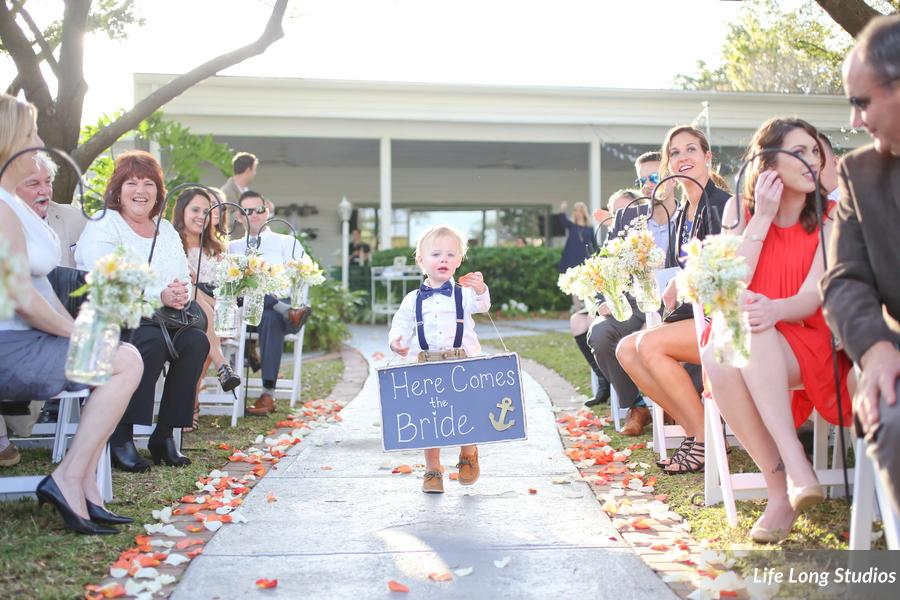 The ring bearer carried a chalkboard sign down the aisle, announcing the arrival of the bride