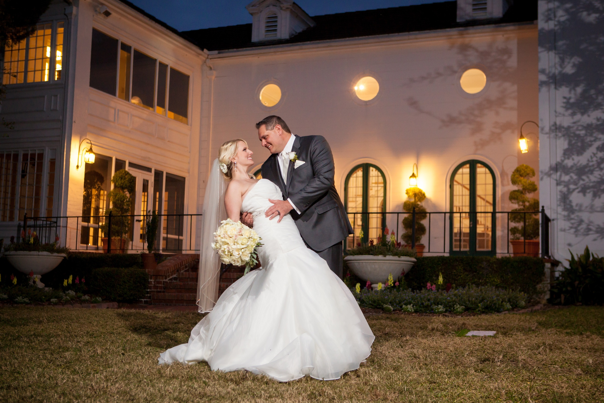 The couple posed in front of the historic mansion at the Marie Selby Gardens
