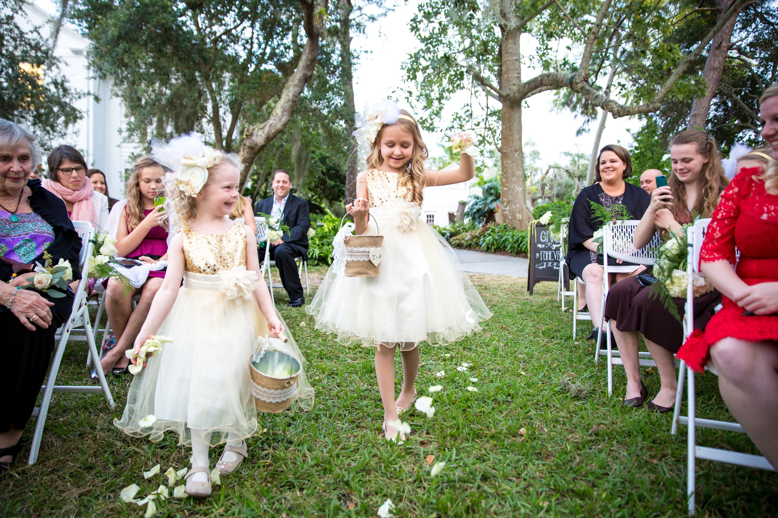 Flowergirls wore gold sequin and tulle dresses and carried burlap-wrapped buckets filled with petals