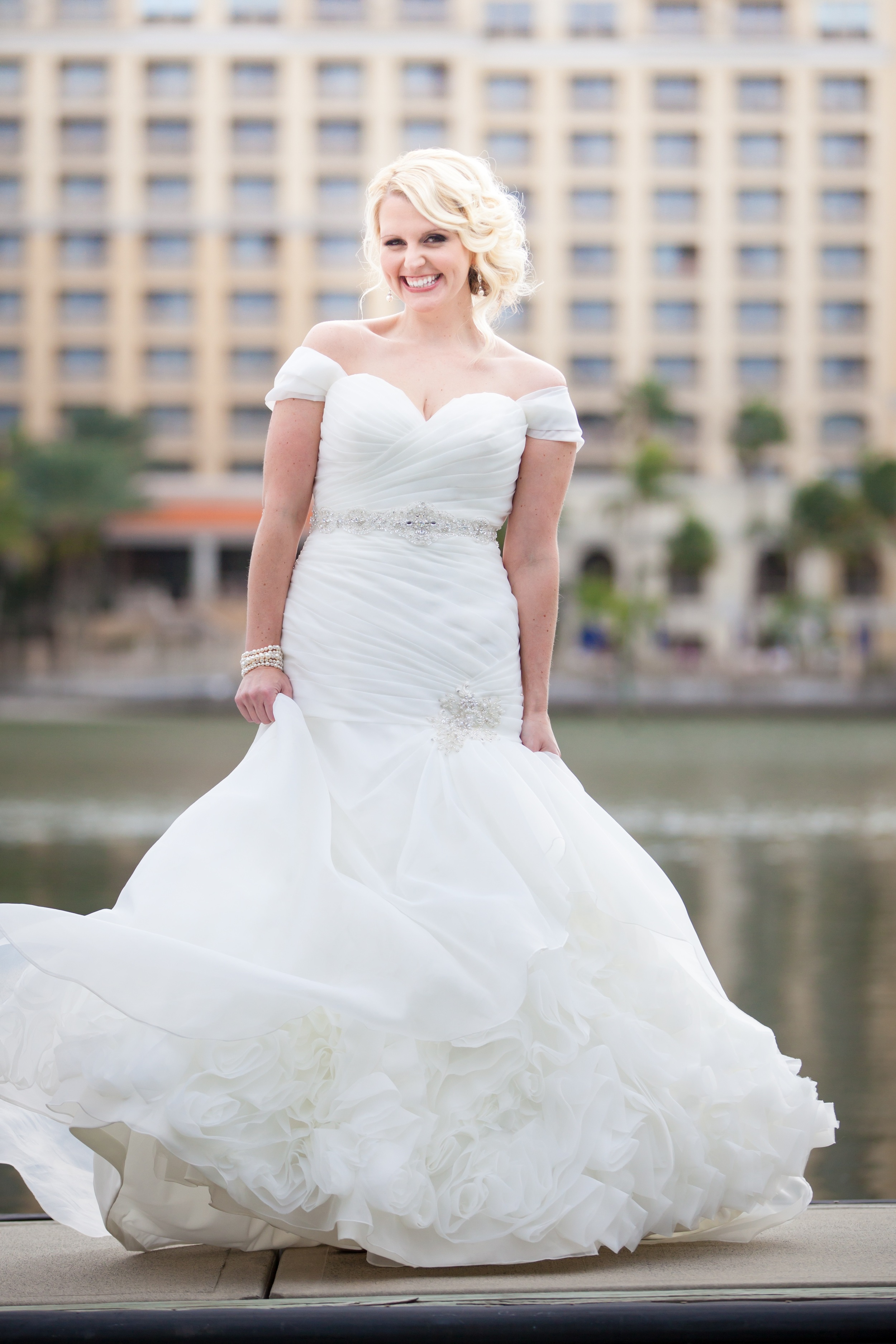 The bride wore a stunning fit and flare organza gown with sheer cap sleeves