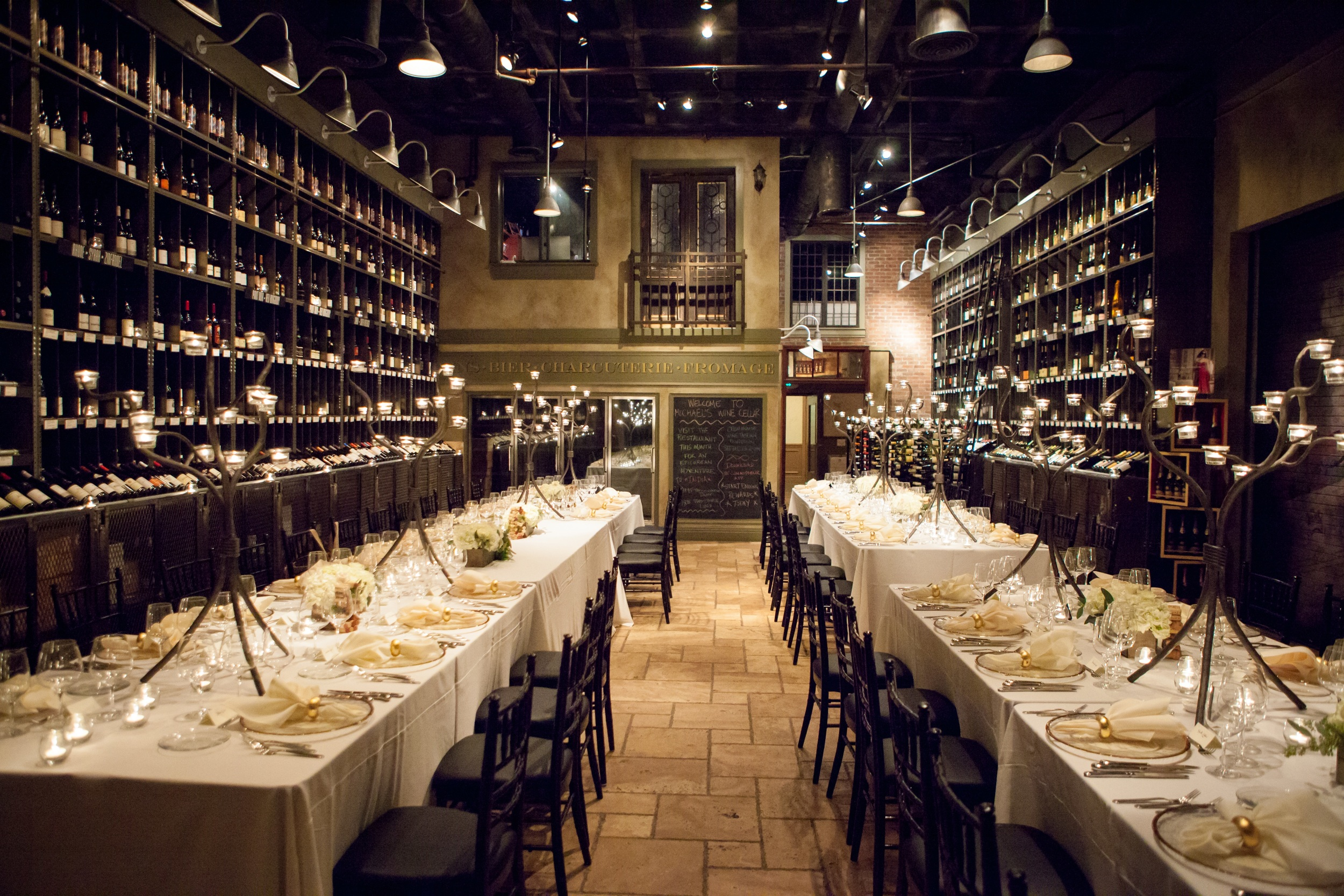 Feasting tables were set in the wine cellar and lined with iron candelabras