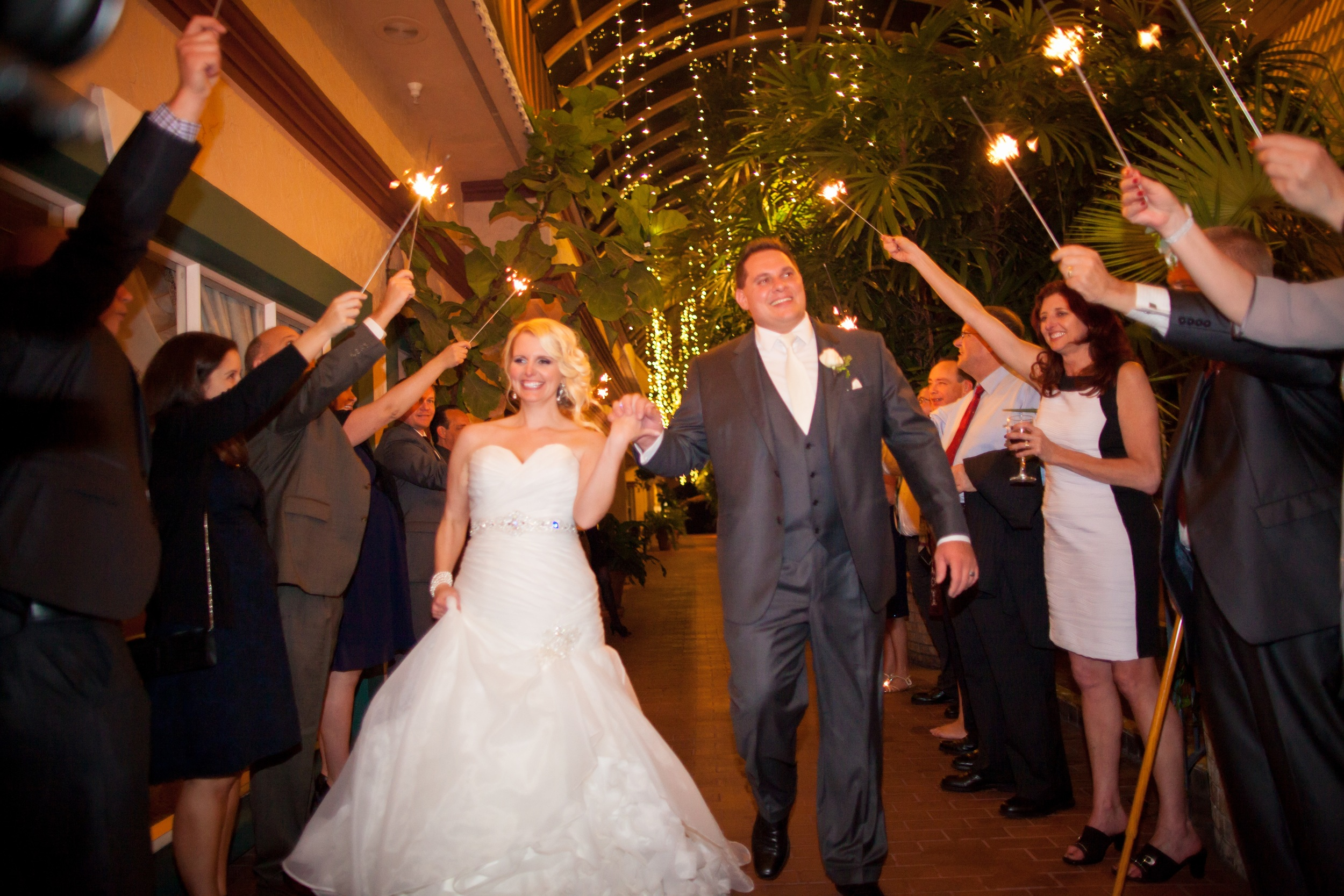 The couple exited through a tunnel of sparklers in the Michael's atrium