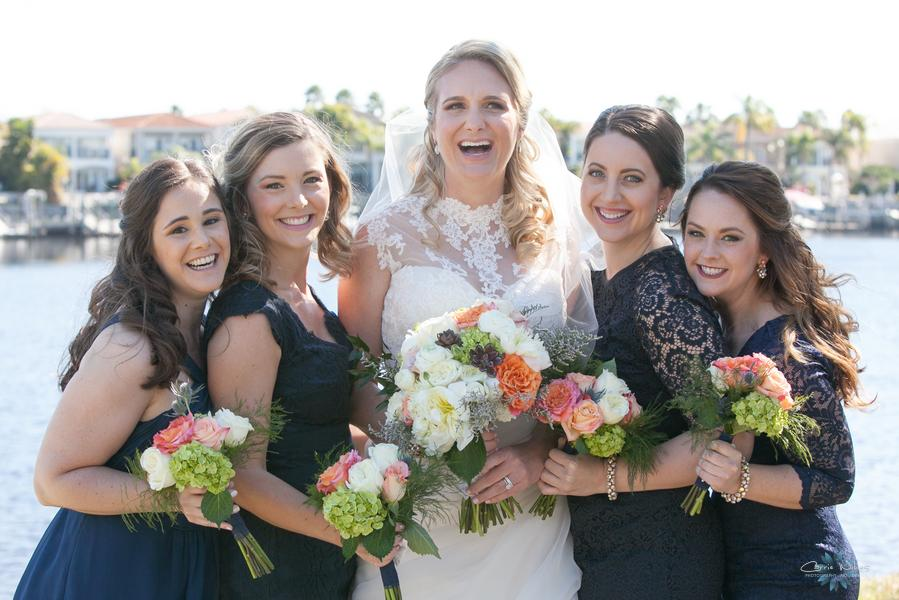 Bridesmaids wore mismatched navy cocktail dresses