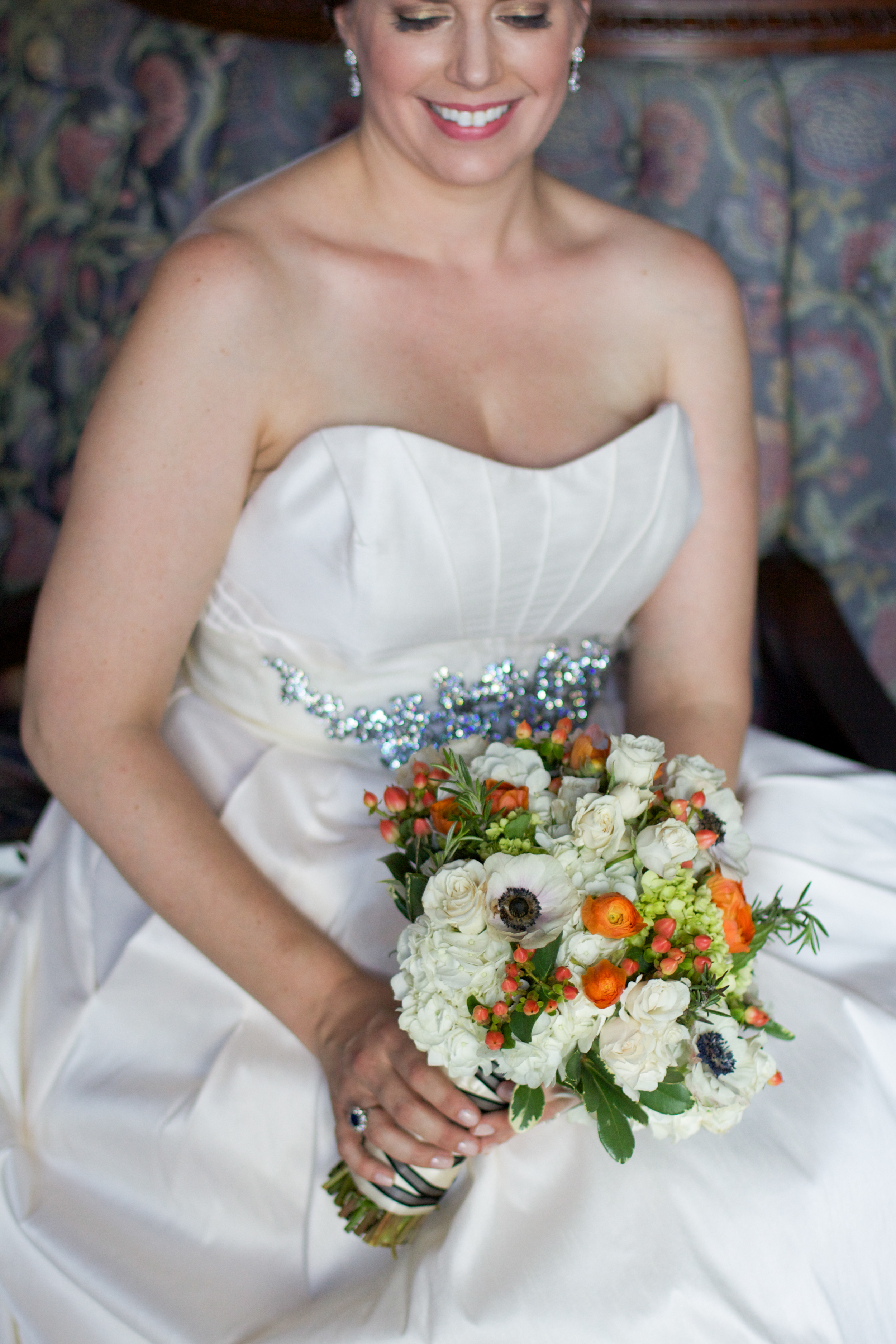 The bridal bouquet combined hydrangea, viburnum,roses, hypericum berries, anemones, renunculus, &rosemary