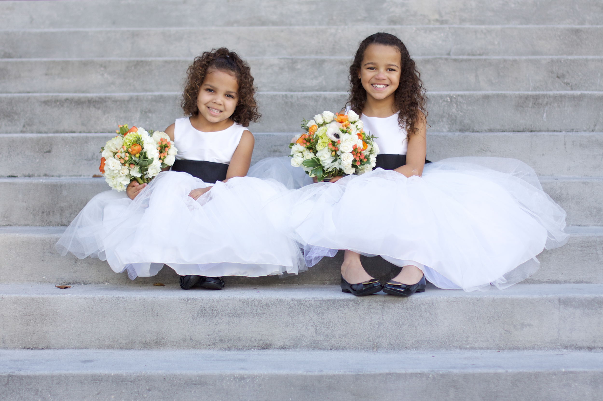 Seriously, how cute are these flowergirls in their classic black and white tulle dresses?