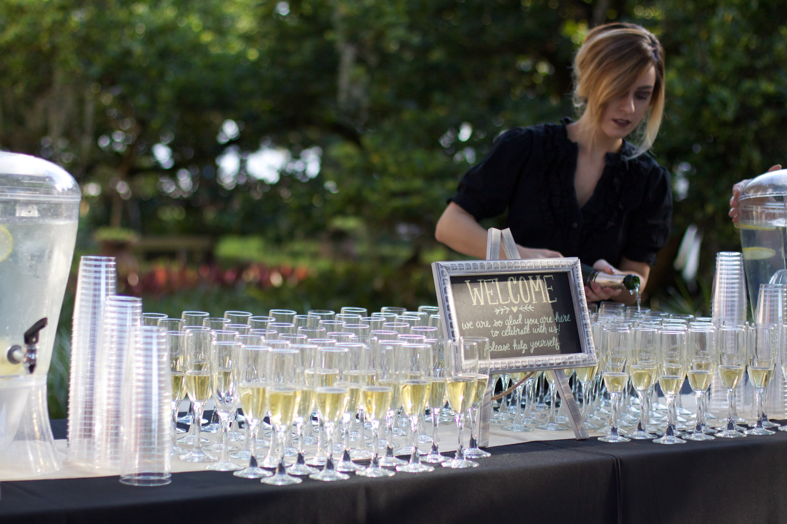 What a pleasant surprise to arrive at an outdoor wedding ceremony and be handed a glass of champagne.