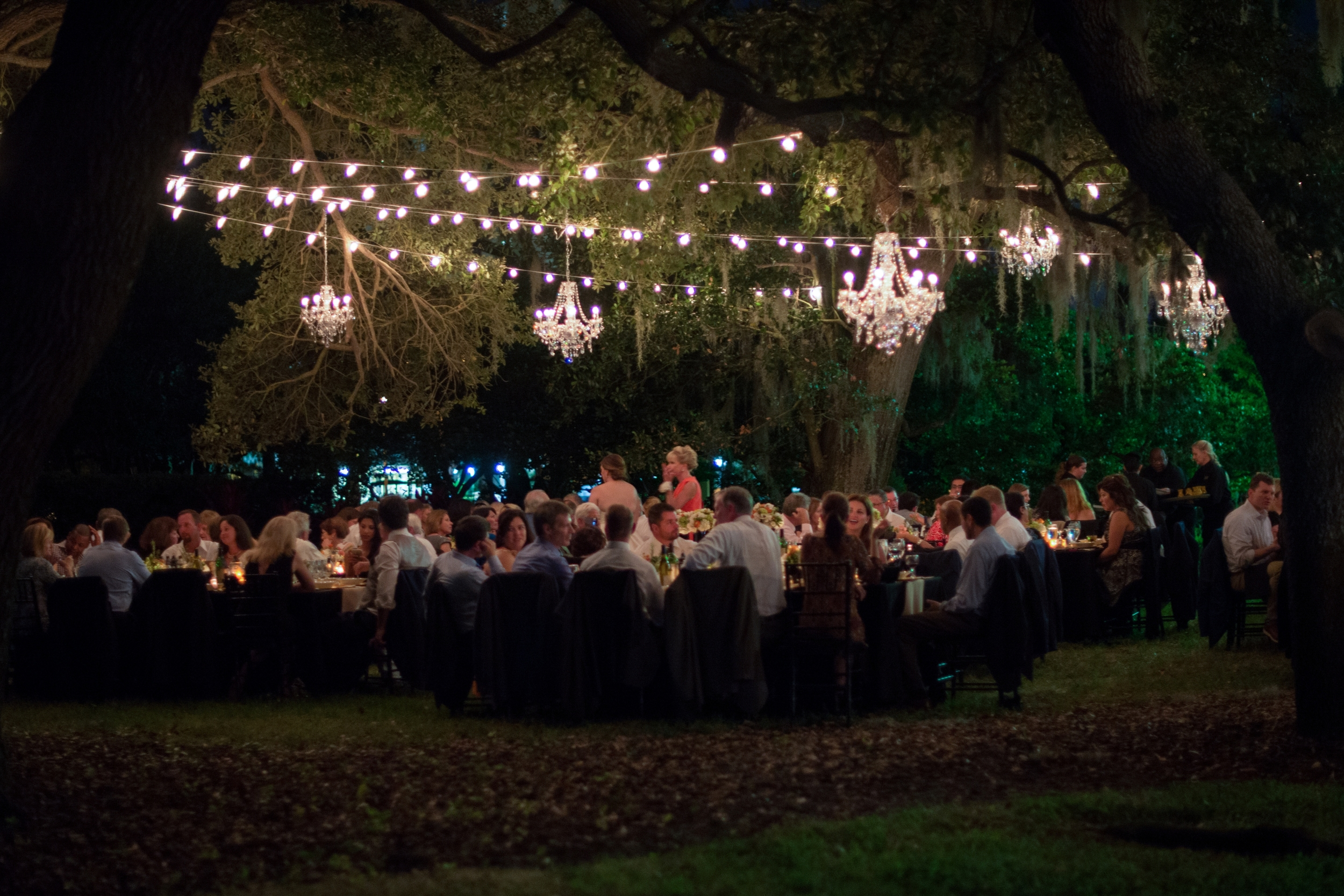 Soft candlelight and crystal chandeliers made for a romantic dinner reception