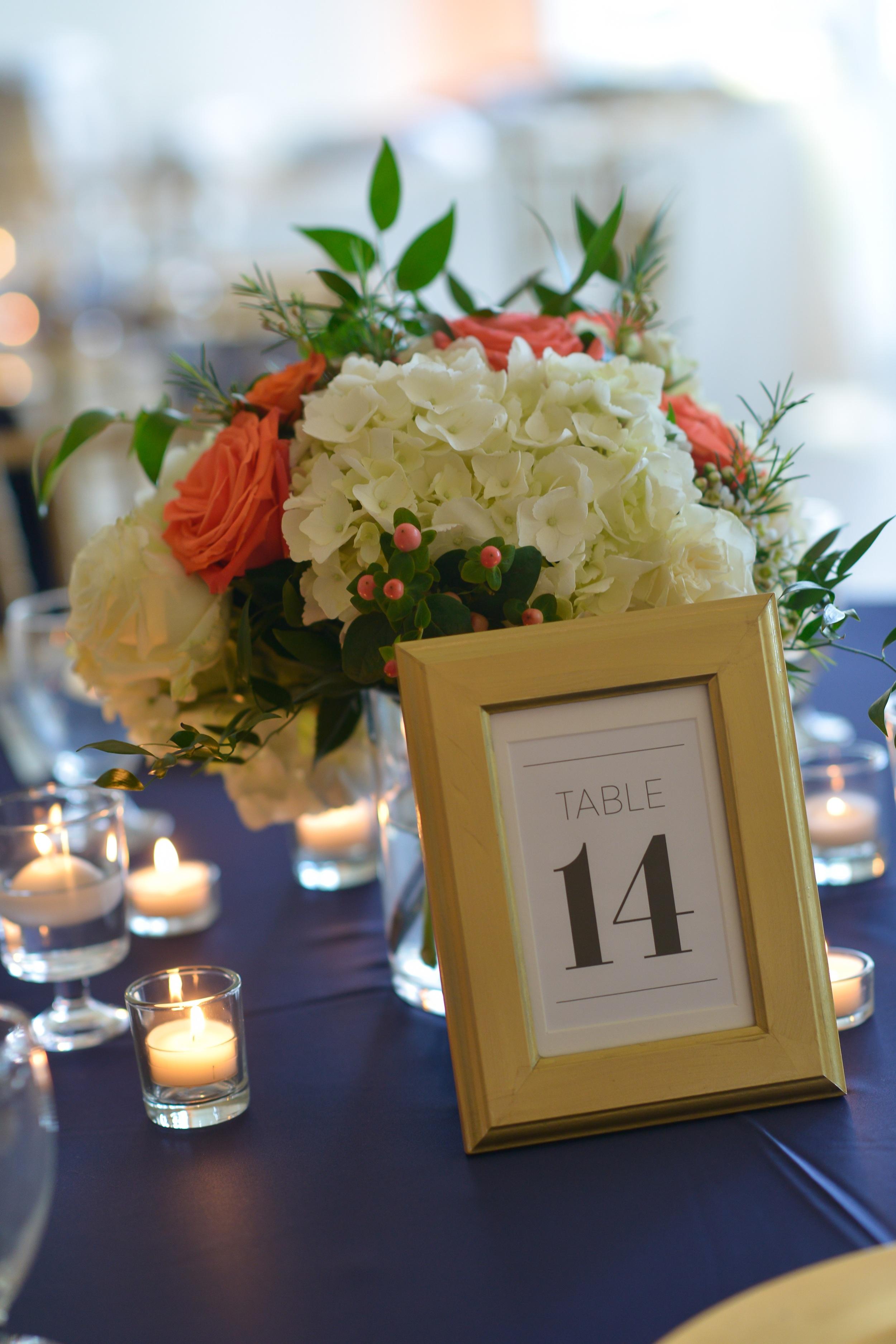 winsor event studio coral peach centerpiece navy wedding