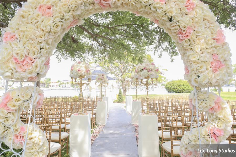 winsor event studio floral arch ceremony davis islands garden club wedding blush