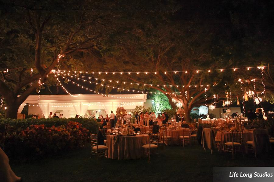winsor event studio outdoor wedding reception canopy string lights davis islands garden club