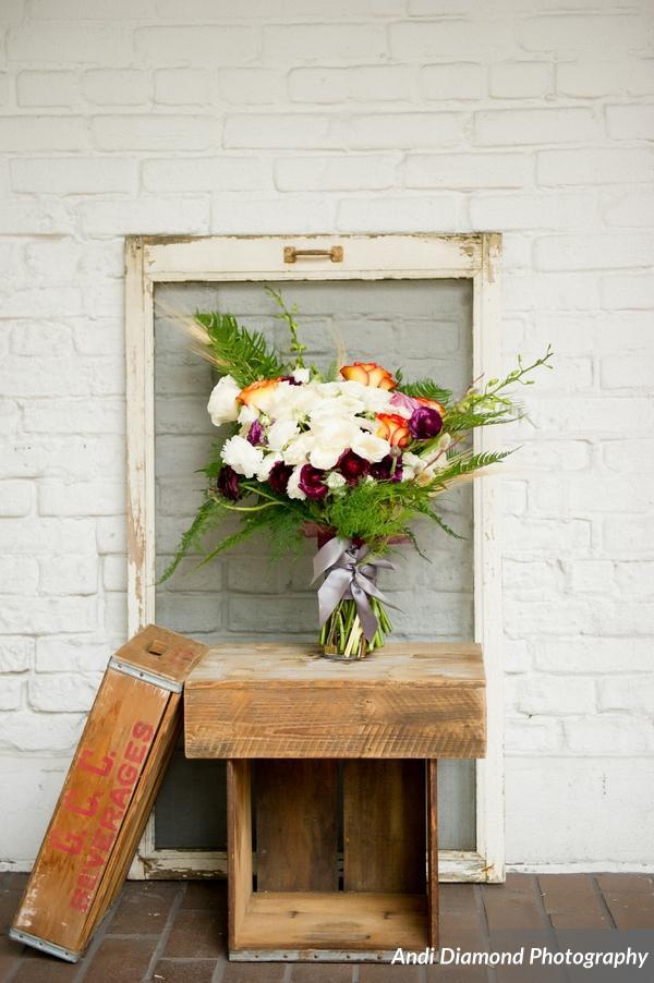 winsor event studio bride bouquet fern natural orange purple ivory
