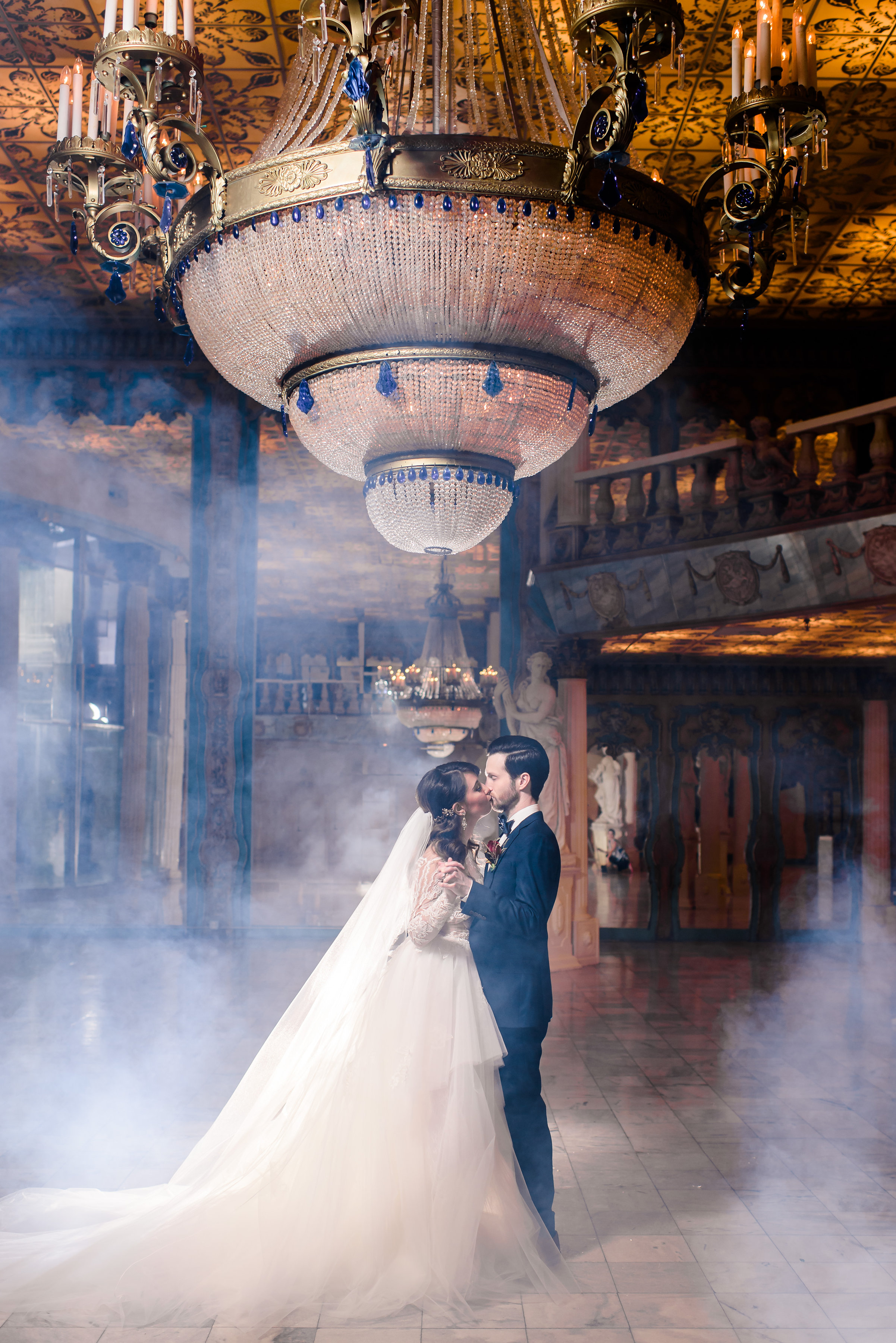 This ballroom looks like something out of a dream!                          The couple shared a dance under the majestic chandelier along a fog-filled marble floor.
