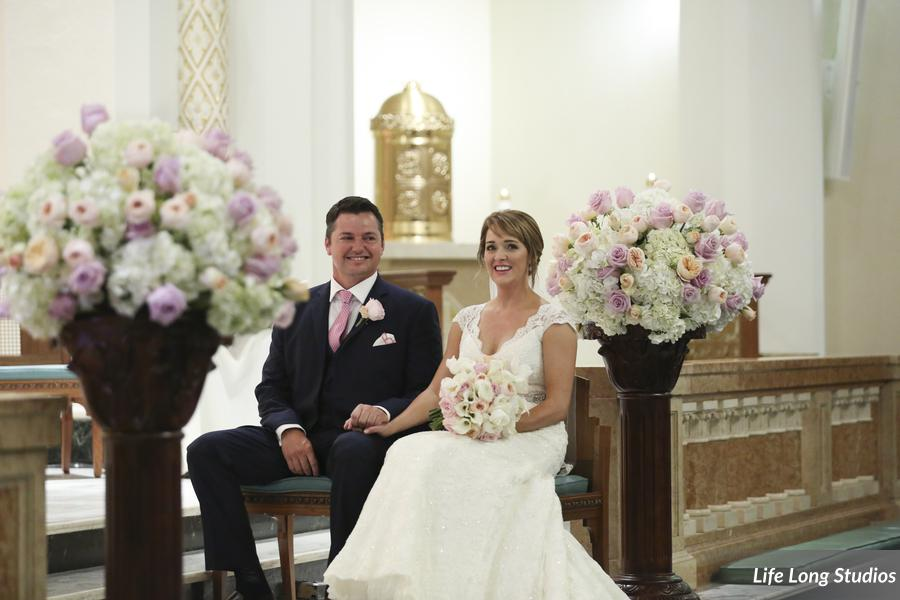 These gorgeous floral arrangements dressed up the Cathedral alter as well as the head table