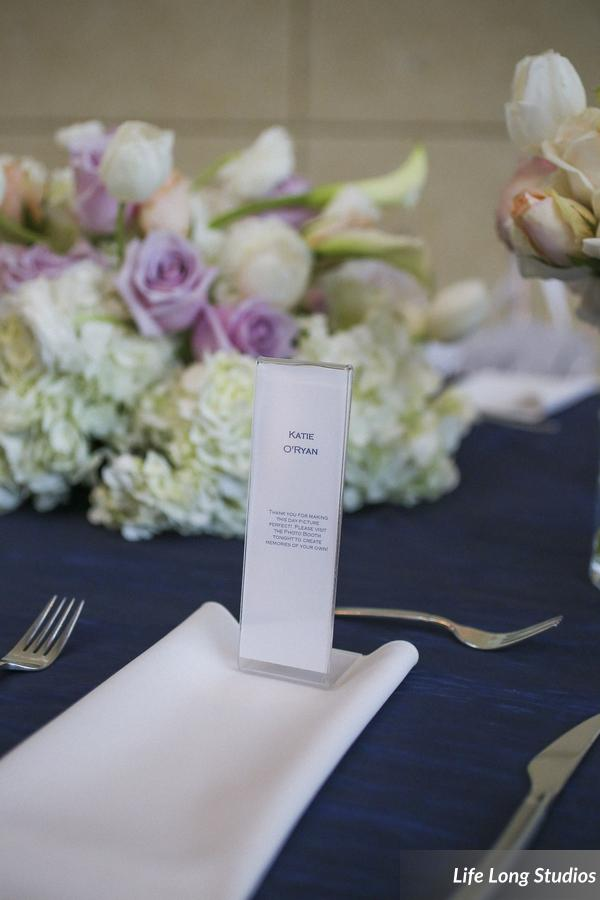 Photo strip frames served as place cards that doubled as favors for guests