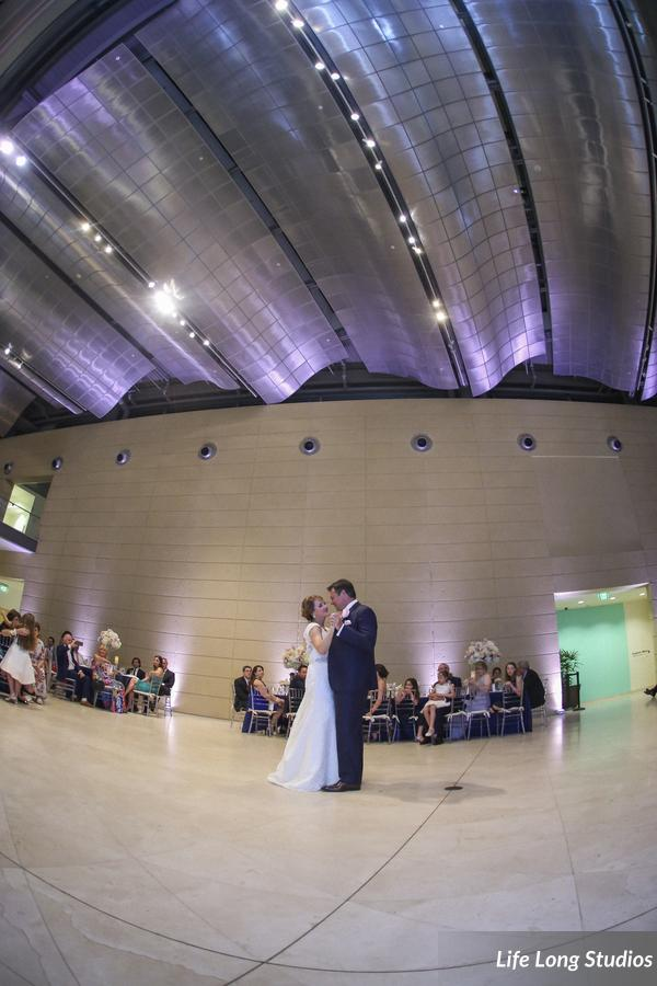Soft pink uplighting along the walls and ceiling created an intimate dance floor at the MFA