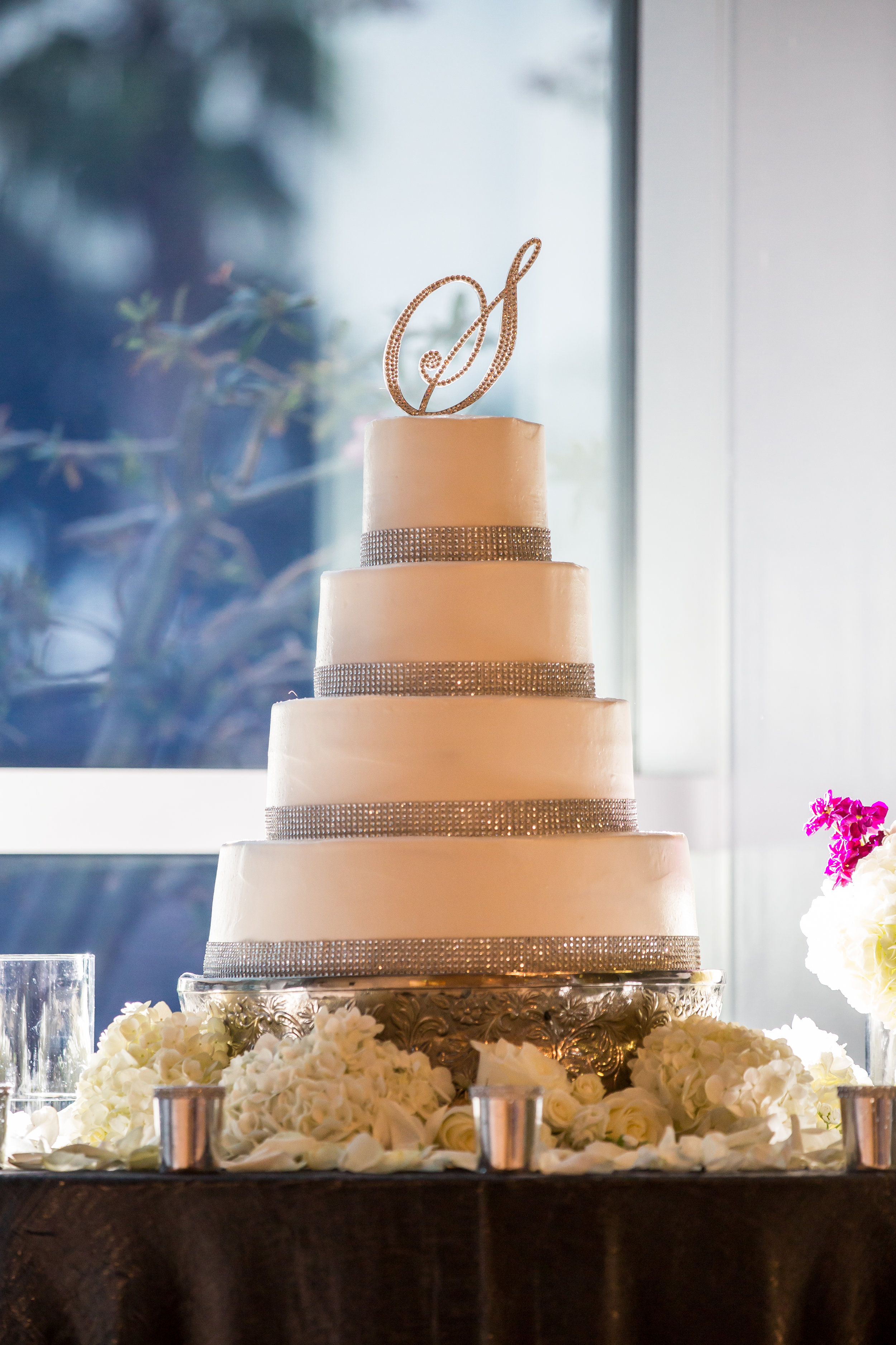 Guests enjoyed chef-attended food stations as well as a decadent chocolate fountain and a four-tier buttercream wedding cake.