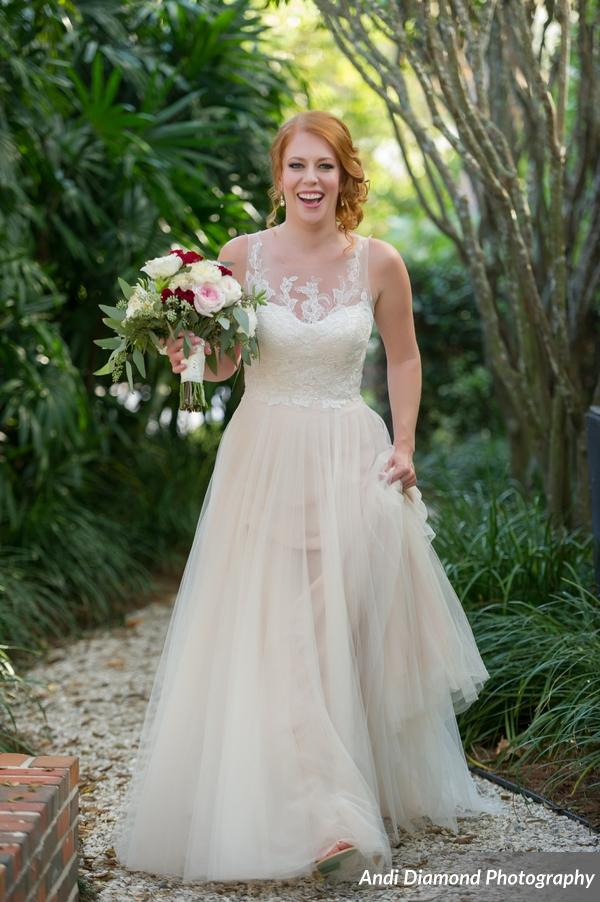 Haley looked radiant in her custom blush lace and tulle gown, and when Max caught a glimpse of her through the window he could not resist the urge to kiss his soon-to-be bride.