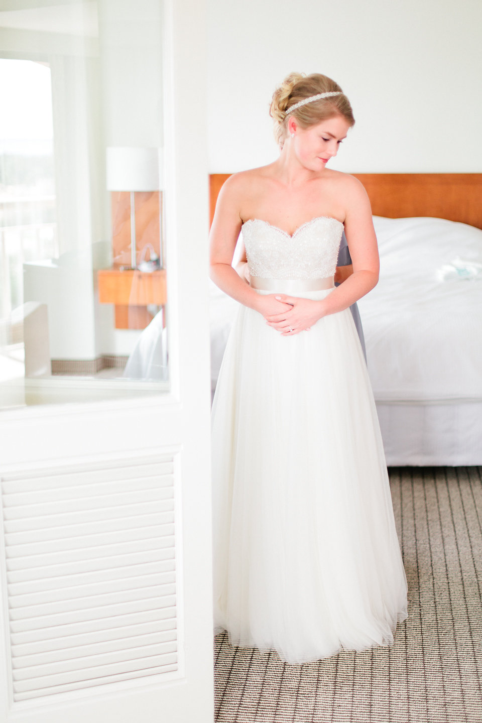 The bride's gown combined soft tulle with an eyelash lace bodice.
