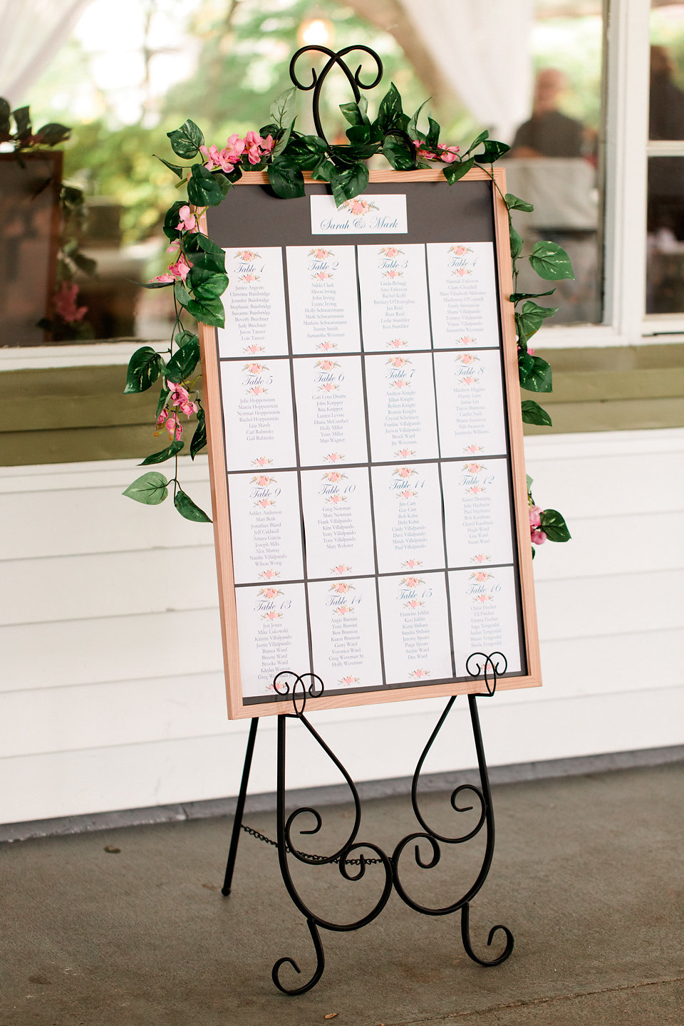 A seating chart directed guests to their table assignments inside.