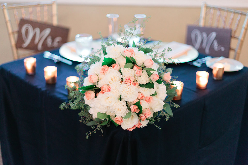 The bridal bouquet was surrounded by votive candles on the sweetheart table.