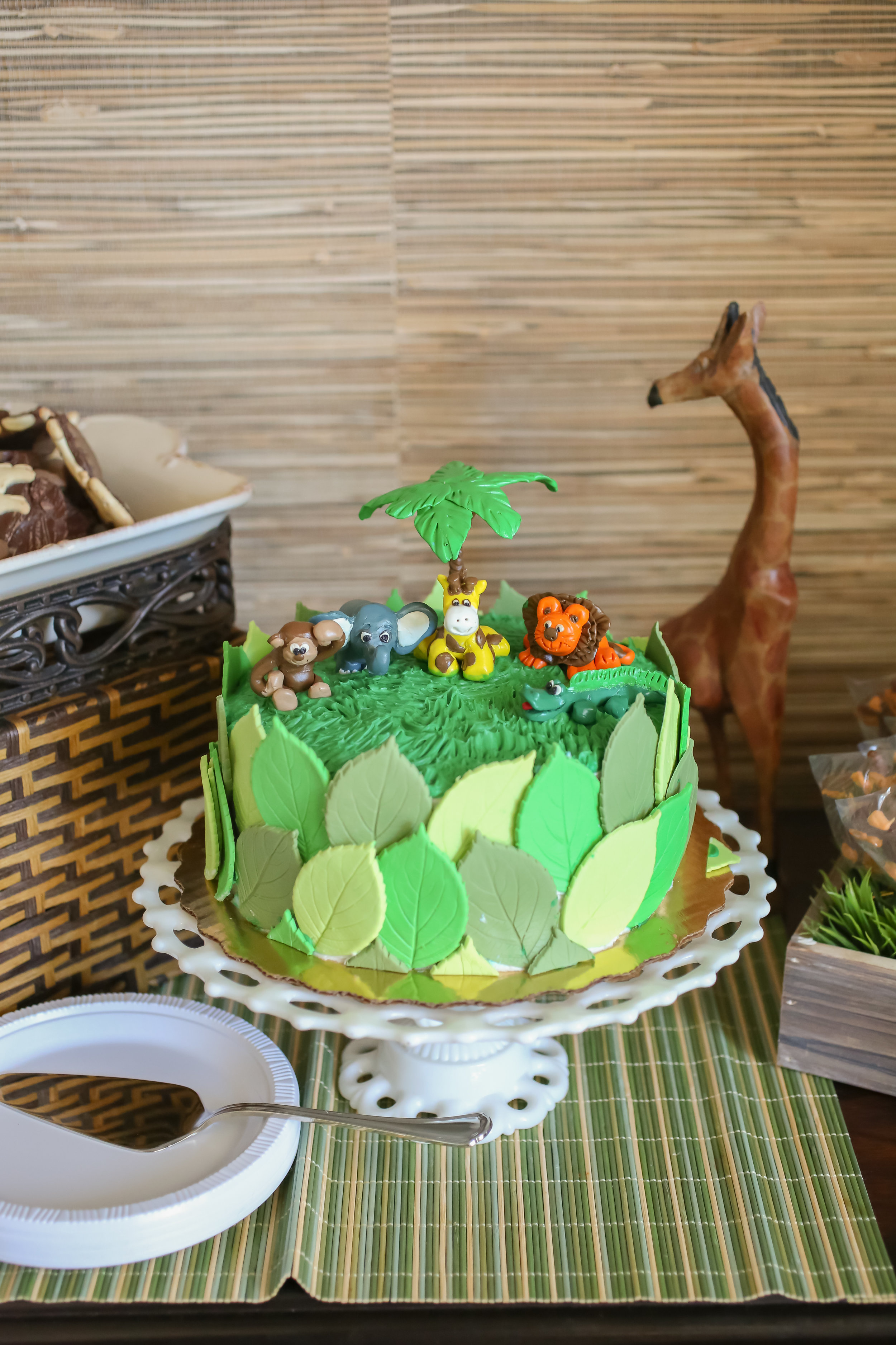 The star of the show (besides the beautiful mommy-to-be!) was the marble cake with gumpaste leaves, topped with handmade clay animals sitting in buttercream grass!