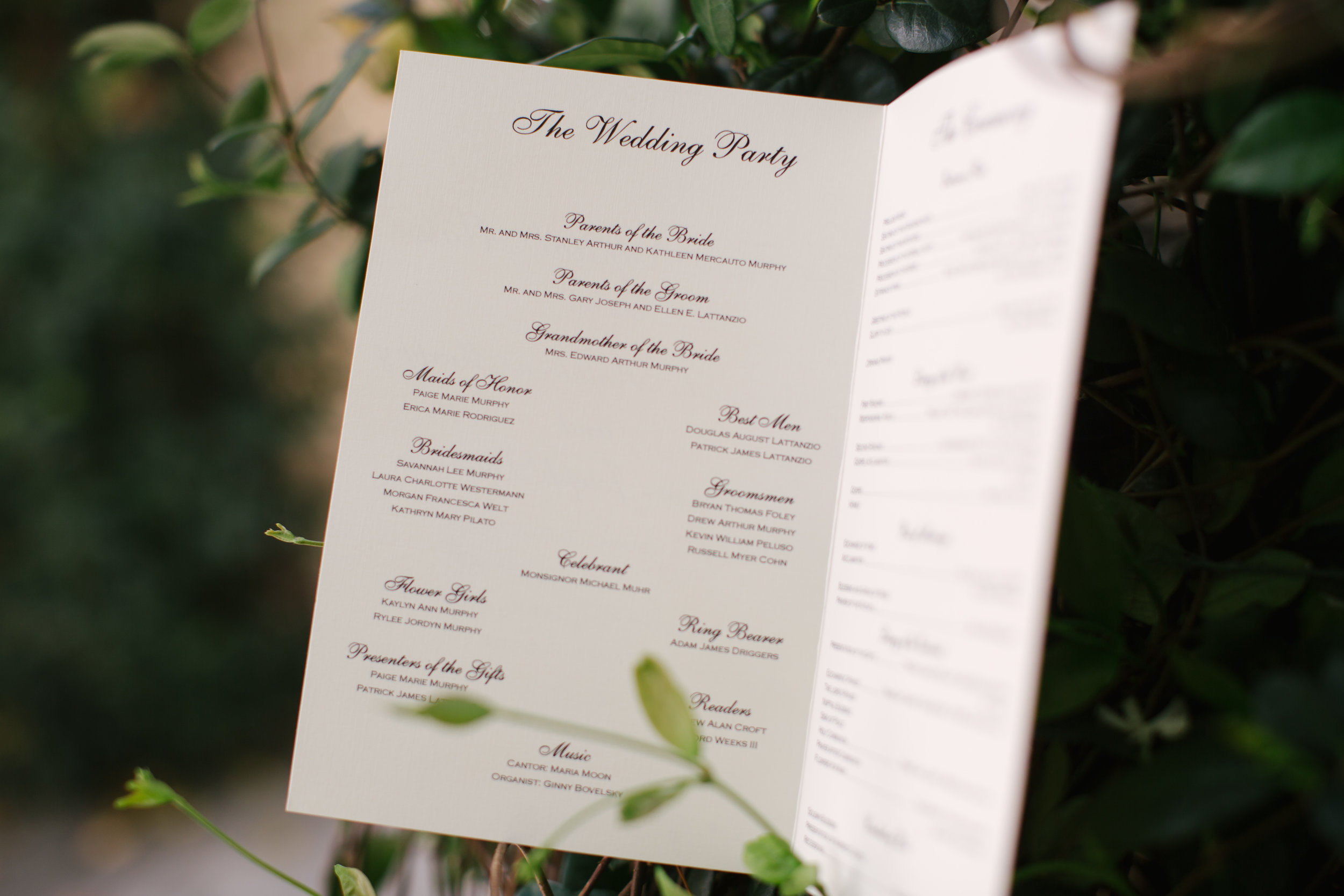 The booklet style program in an elegant black and white design with script detailing.