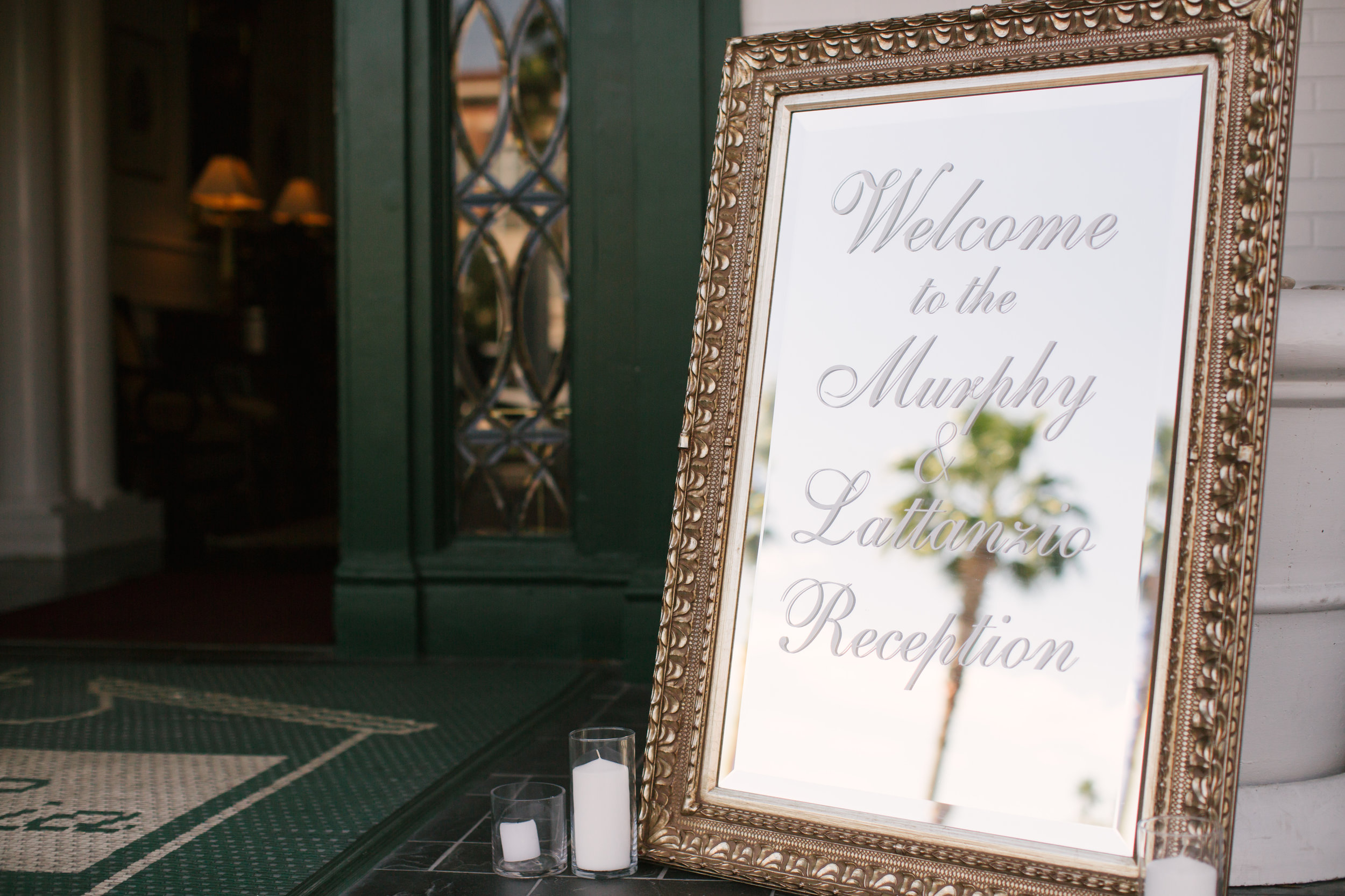 An engraved gold mirror surrounded by candles welcomed guests to the reception.