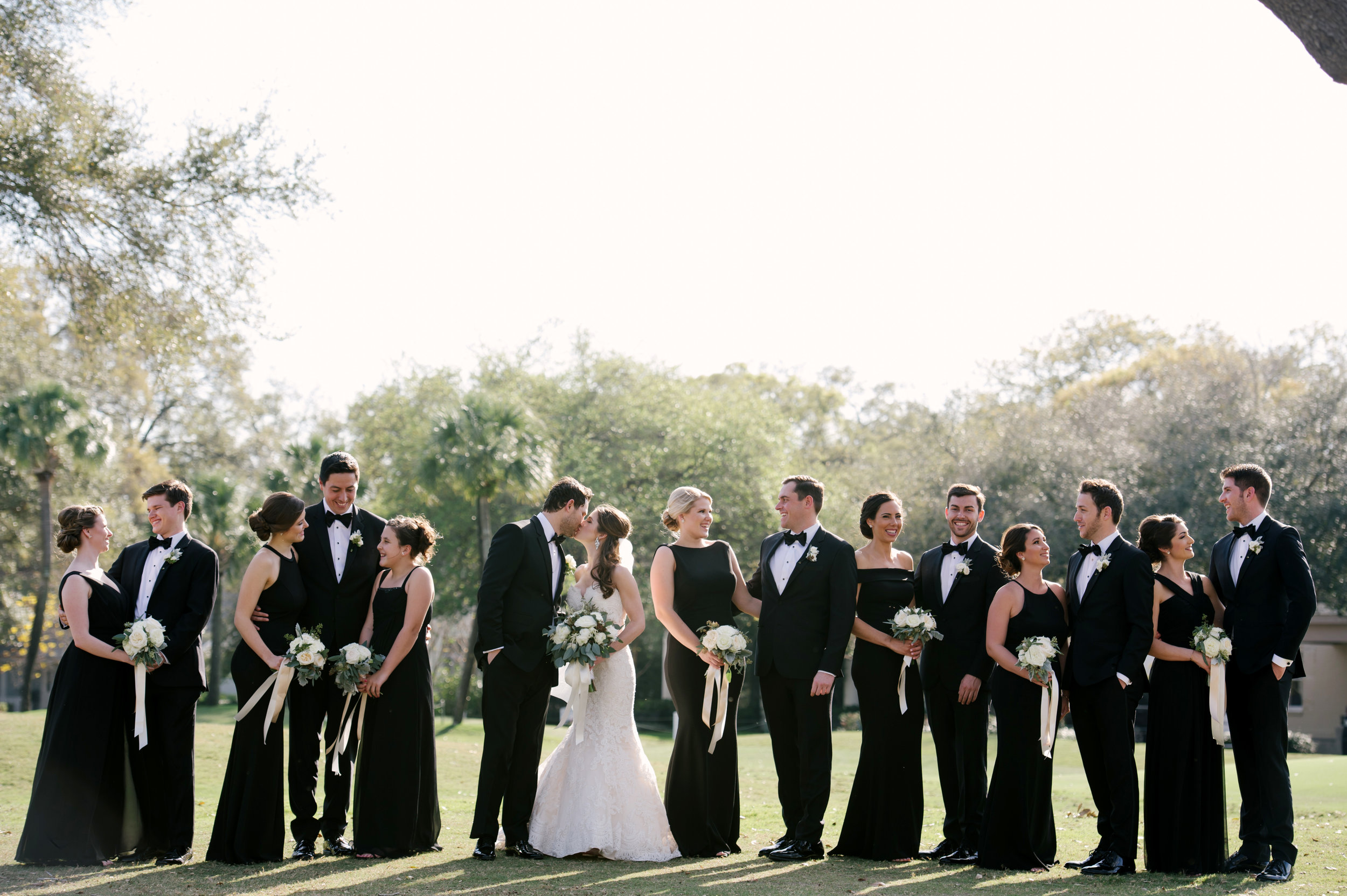 Classic, elegant styling appeared throughout, with the wedding party decked out in formal black attire.