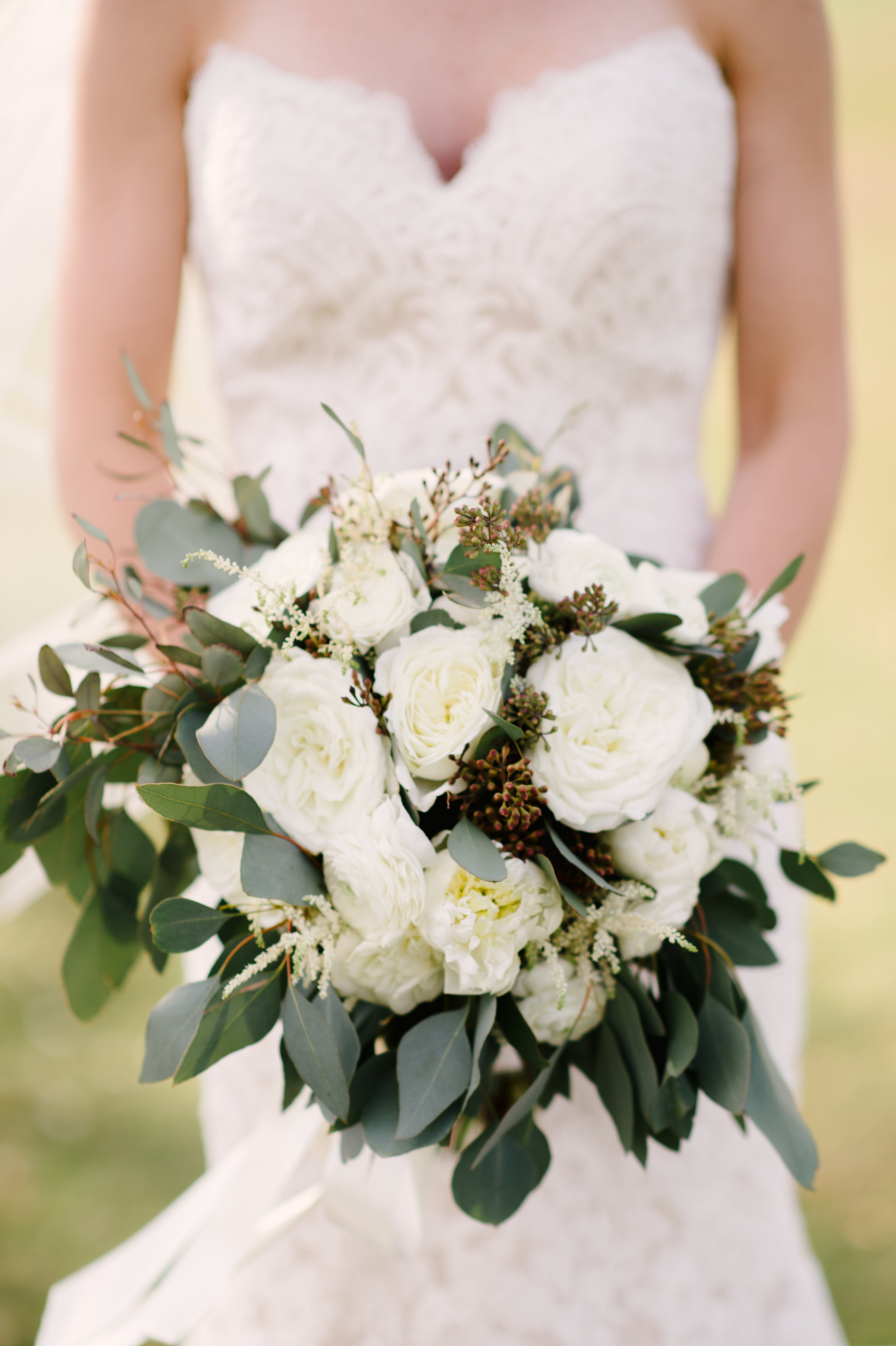 The bride's bouquet consisted of seeded eucalyptus and ivory garden roses.